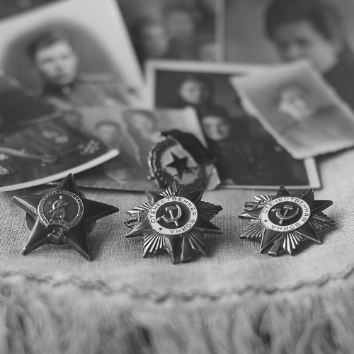 forces medals and pictures of men in the forces